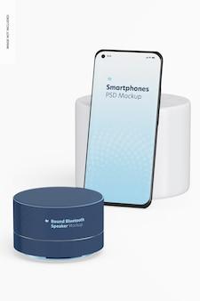 Ronde bluetooth-luidspreker met smartphonemodel