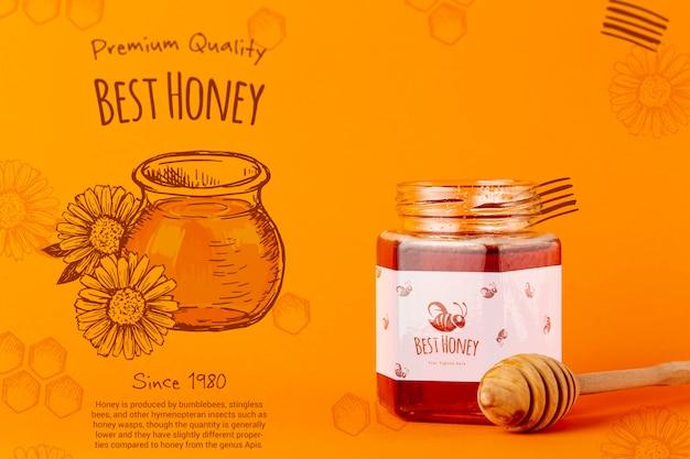 Sabrosa miel en frasco con maqueta