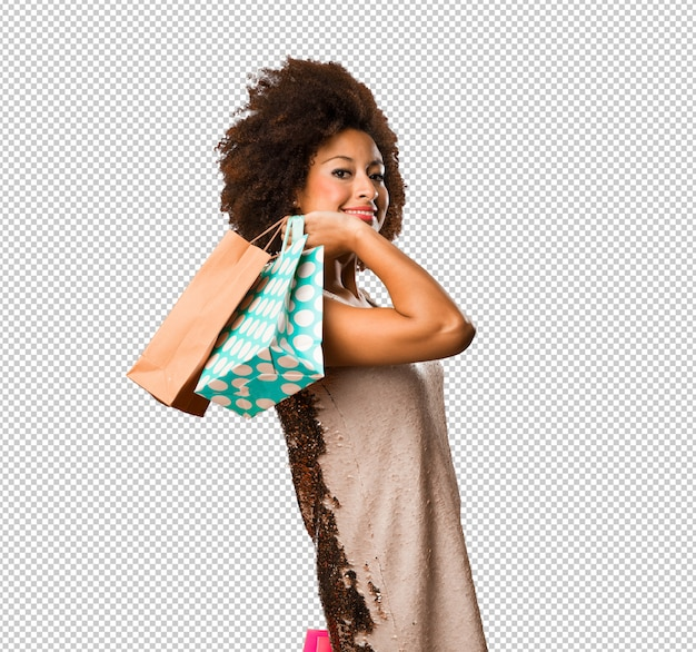 Sacchetti della spesa della tenuta della giovane donna di colore