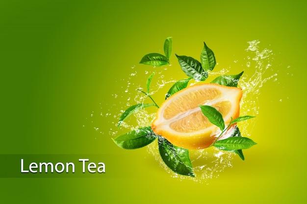 Salpicaduras de agua sobre limón y hoja de té verde aislado sobre fondo verde