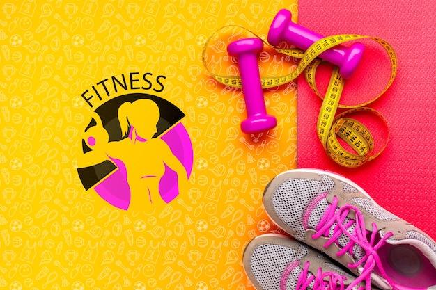 Scarpe da fitness e attrezzature per pesi