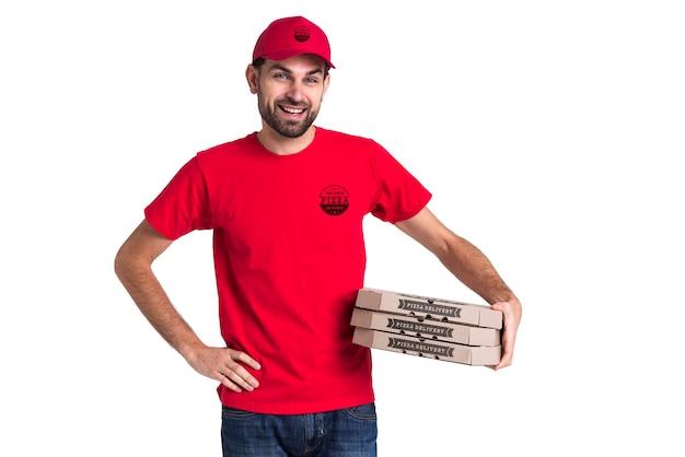 Scatole della tenuta del ragazzo della pizza del corriere
