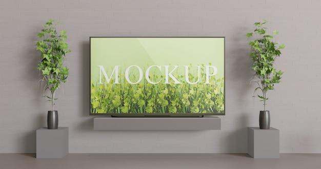 Scherm tv mockup op tafel. vooraanzicht schermmodel met paar decoratieplanten