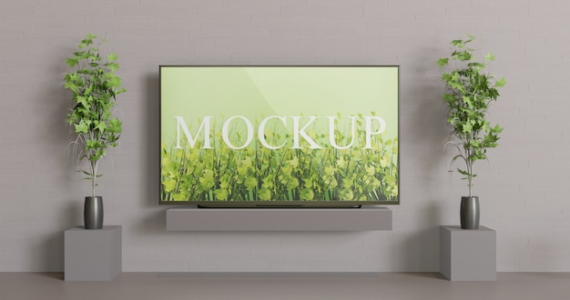 Schermo tv mockup sul tavolo. modello di schermo vista frontale con piante di decorazione di coppia