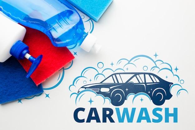 Schoonmakende hulpmiddelen met autowasseretteconcept