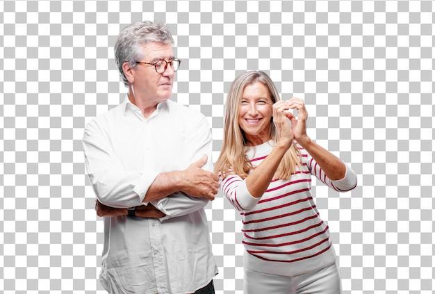 Senior fresco marido y mujer de pie de lado