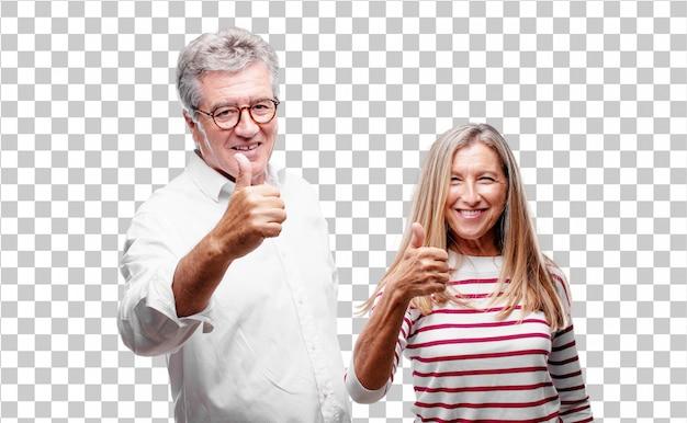 Senior marido y mujer cool con una mirada satisfecha, orgullosa y feliz con los pulgares hacia arriba