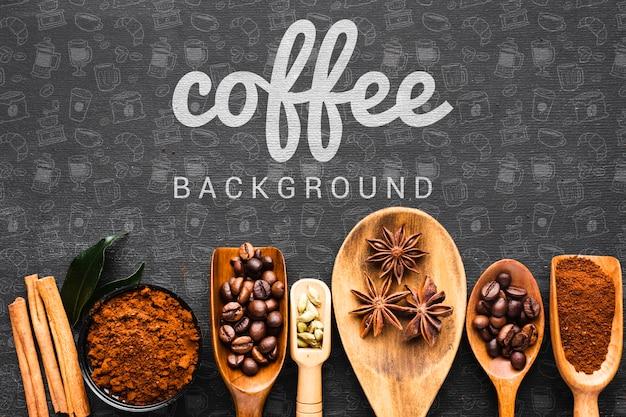 Sfondo di caffè con un cucchiaio di legno per il caffè