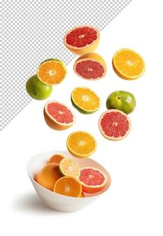 Sinaasappelen en mandarijnen die in een kom vliegen