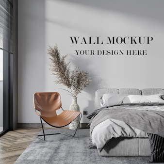 Slaapkamer lege muur mockup achter droge plant
