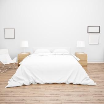 Slaapkamer of hotelkamer met tweepersoonsbed met dekbed of dekbed van wit bed, houten meubels en parketvloer