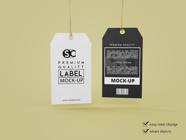Sluit omhoog op etiketmodel dat door een draad wordt vastgehouden