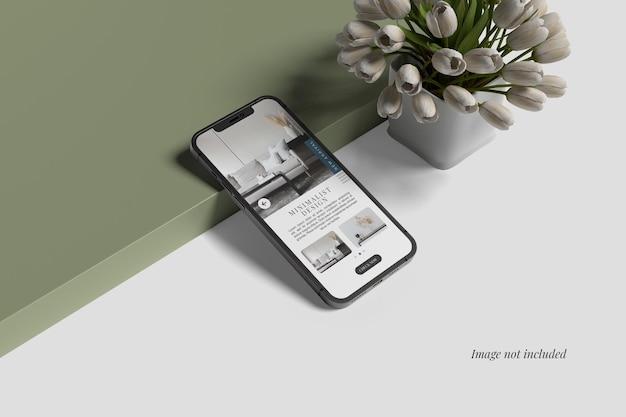 Smartphone 12 max pro mockup naast tulp