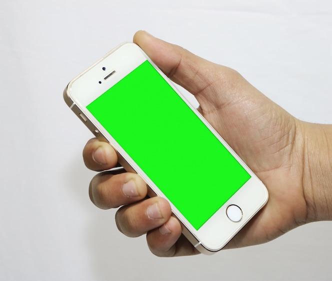Smartphone con pantalla verde en la mano