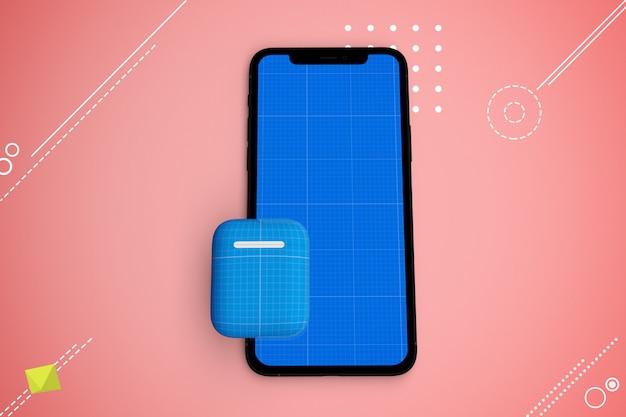 Smartphone con schermo mockup e auricolari, concetto di musica app