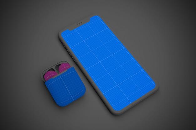 Smartphone con schermo mockup e auricolari