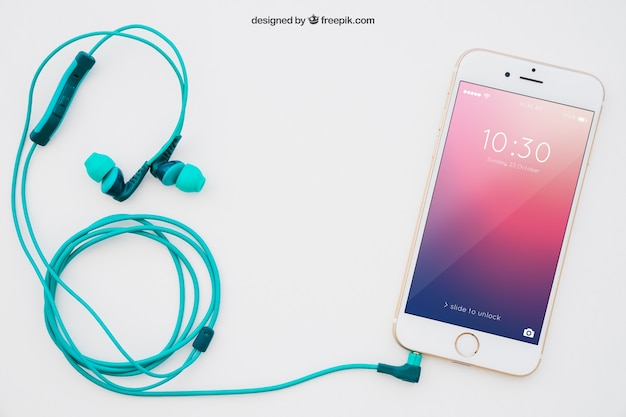 Smartphone en oortelefoon mockup