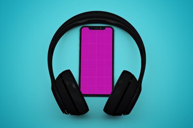 Smartphone con maqueta de pantalla y auriculares, concepto de aplicación de música