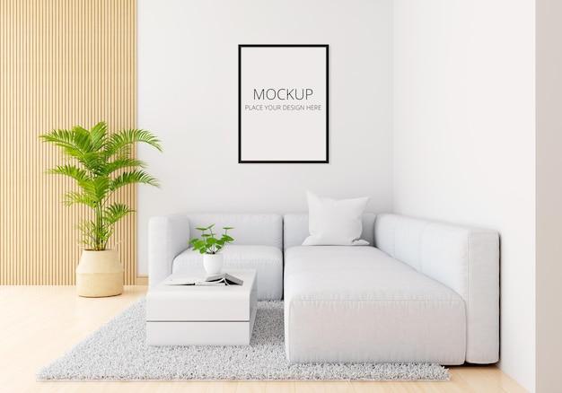 Sofá gris en sala de estar blanca con maqueta de marco