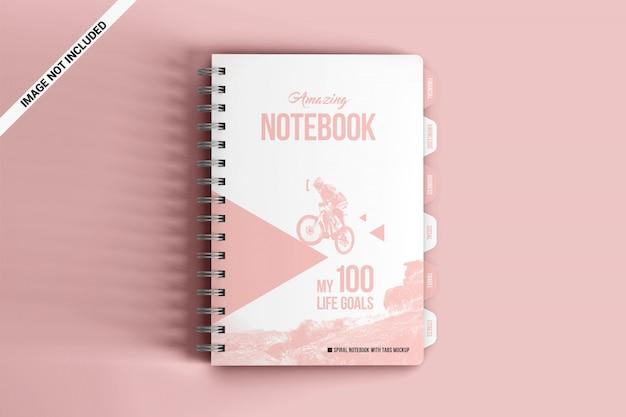Spiraalvormig notitieboekje met tabbladen bovenaanzicht mockup