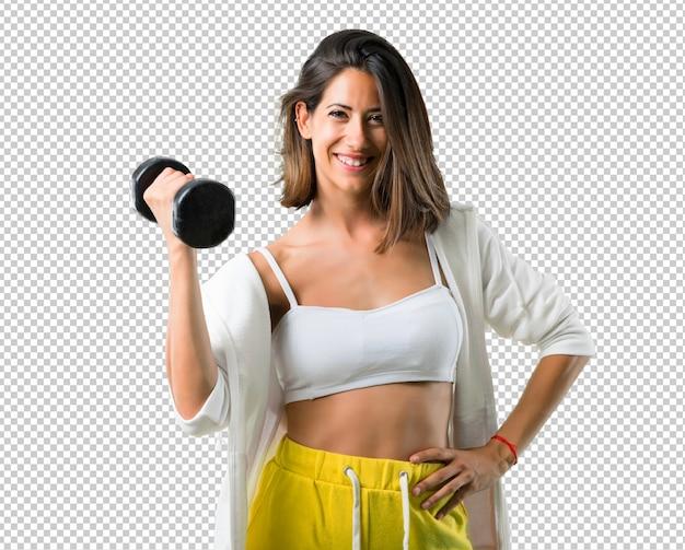 Sportvrouw die gewichtheffen maken