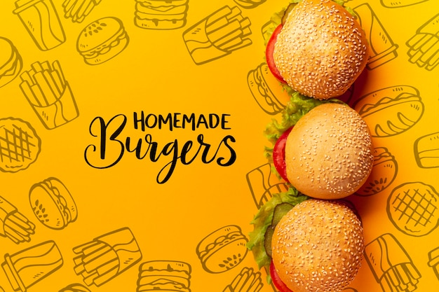 Stapel hamburgers op fast food doodle achtergrond