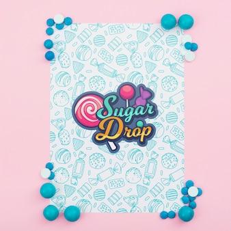 Suiker drop poster mock-up met blauwe snoepjes
