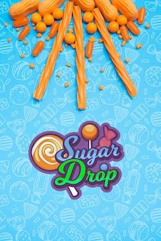 Suikerdaling met arrangement van oranje snoepjes