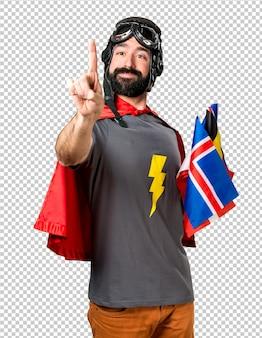 Superhéroe con muchas banderas tocando en pantalla transparente.