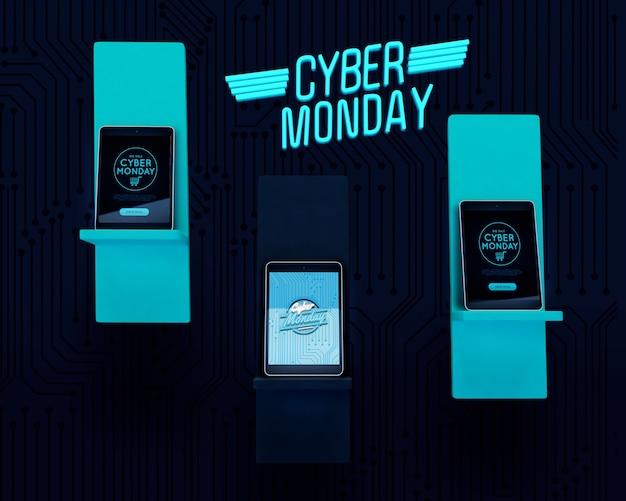 Tabletten ingesteld op fluorescerende planken cyber maandag