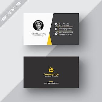 Tarjeta de negocios blanca y negra con detalles amarillos