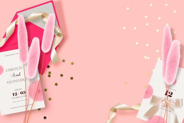 Tarjeta de invitación de boda sobre fondo rosa
