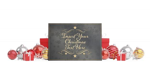 Tarjeta de navidad en superficie blanca con adornos navideños maqueta