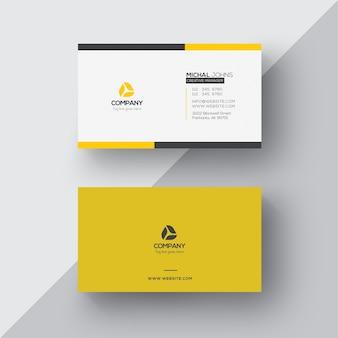 Tarjeta de negocios amarilla y blanca