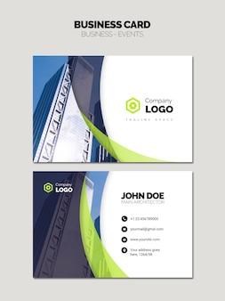 Tarjeta de visita con logotipo de la empresa y edificio del cielo