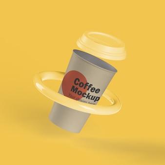 Taza de café desechable en un anillo