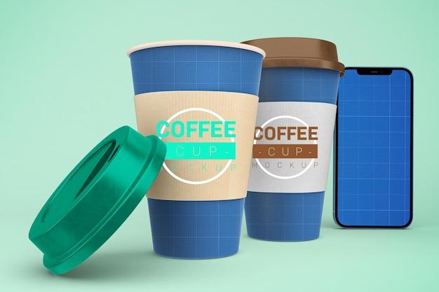 Tazas de café y teléfono inteligente