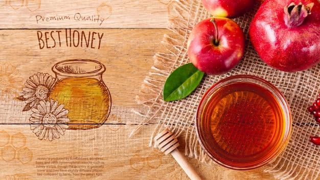 Tazón con miel al lado de manzanas