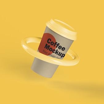 Tazza di caffè usa e getta in un anello