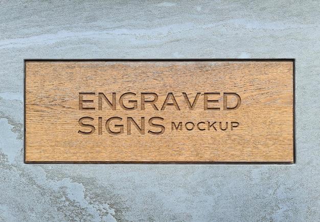Teken logo gegraveerd op houten plaat mockup