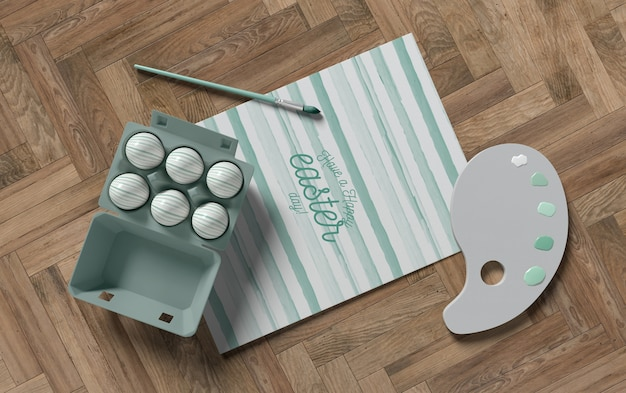 Tekengereedschappen en bekisting met eieren op tafel