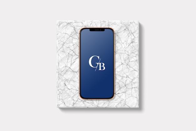 Teléfono inteligente mockup ángulo superior con mármol