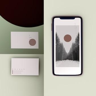 Teléfono de marca de escena plana y maqueta de tarjeta de visita