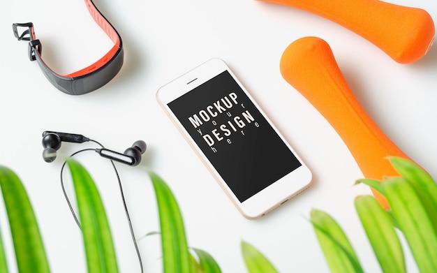 Teléfono móvil de maqueta para fitness concepto saludable.