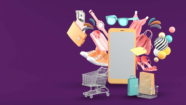 Teléfono móvil rodeado de ropa y accesorios en púrpura