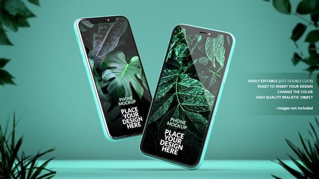 Telefoons mockup op een groene achtergrond met planten