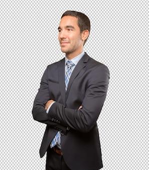 Tevreden jonge zakenman poseren