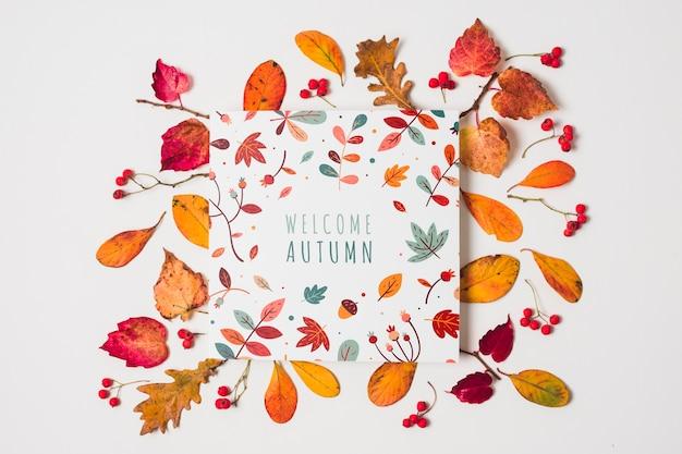 Tipografia piatta con foglie gialle