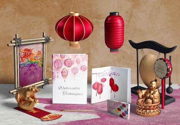 Toebehoren en notitieboekje van het vooraanzicht het chinese nieuwe jaar