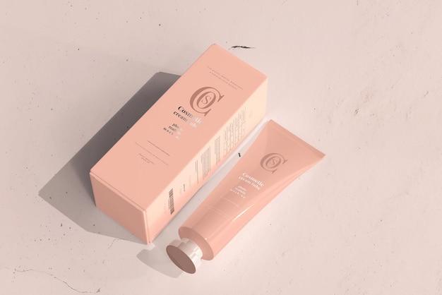 Tubo de crema cosmética con maqueta de caja
